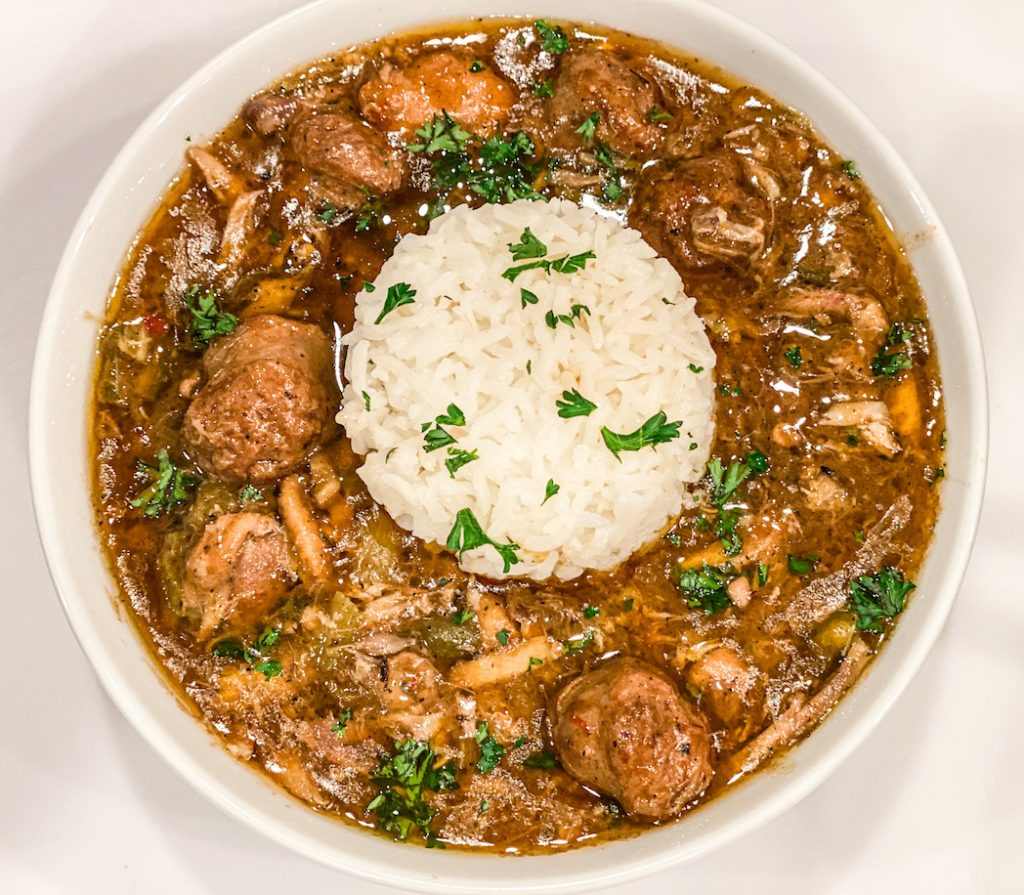 Hearty and flavorful chicken and sausage gumbo served with white rice