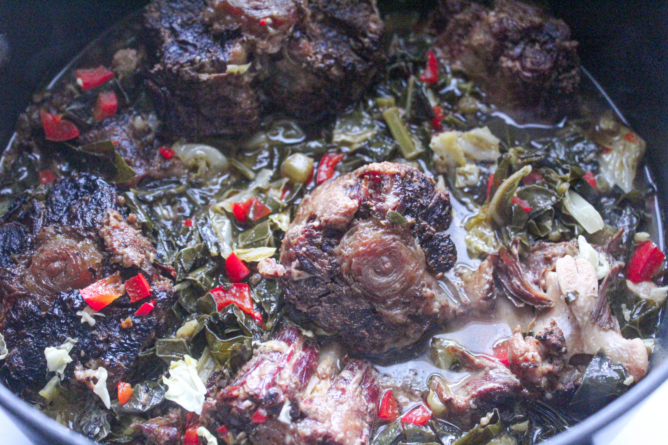 Smoked ox tails with collard greens